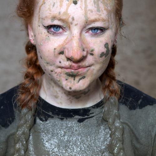 Nederland, Wijchen, 19 maart 2016 In Wijchen wordt dit weekend de Strong Viking Obstacle run gehouden, ook wel mudrun. Een hardloopwedstrijd met hindernissen door modder en water. Deze deelneemster, onder de modder, is moe van alle inspanningen. Foto: Stijn Rademaker/HH